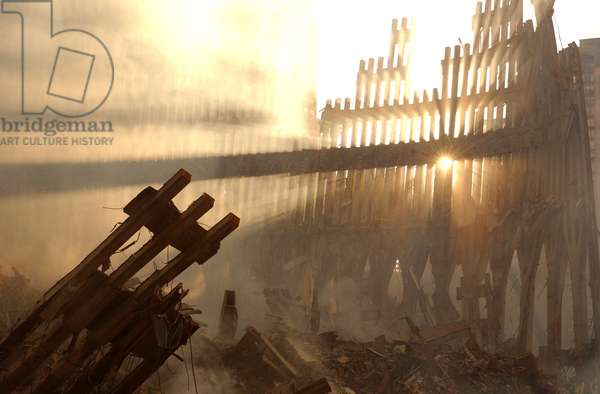 Sun streams through the dust over the wreckage of the World Trade Center. New York City, Sept. 15, 2001