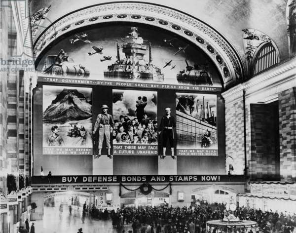 Grand Central terminal Mural. A huge photo mural above the Grand Central Station Concourse promotes Defense Bonds and Stamps. 1942
