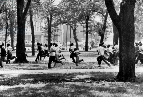 Civil Rights demonstrators make a successful break for their staging point in Birmingham, Alabama, 1963