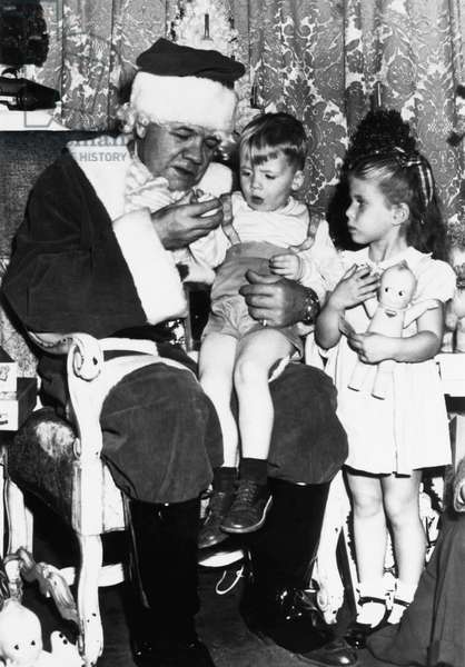 New York Yankees. Retired baseball player Babe Ruth, dressed up as Santa for the Sister Kenny Foundation for infantile paralysis victims, c.late 1940s