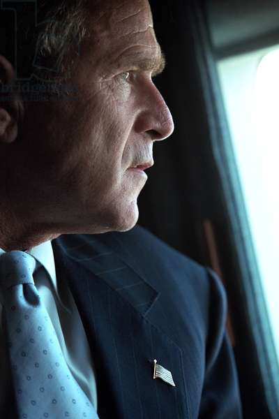 President George W. Bush surveys the damage to the Pentagon from Marine One, Sept. 14, 2001. Three days after the 9-11 Terrorist Attacks, Bush 43 was enroute to New York City to visit the devastated World Trade Center site