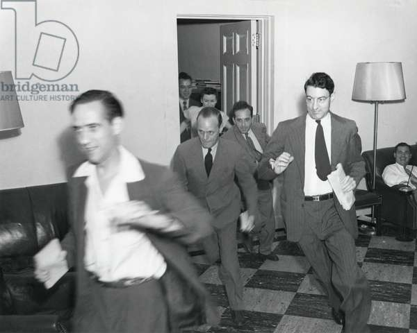Reporters running through the White House after the announcement of Japan's surrender, ending WW2. August 14, 1945. - (BSLOC_2014_15_21): Reporters running through the White House after the announcement of Japan's surrender, ending WW2. August 14, 1945. - (BSLOC_2014_15_21)
