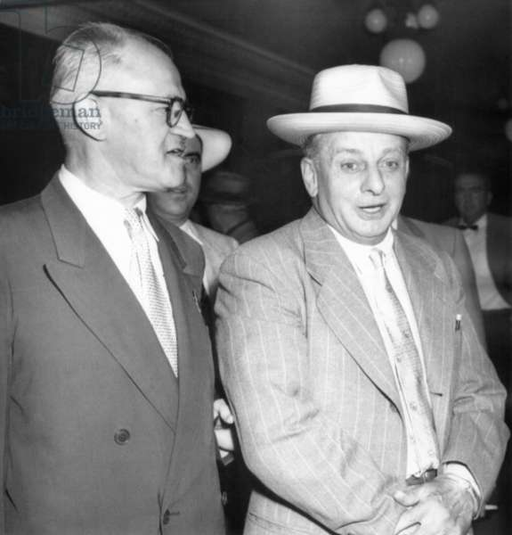 Roger Touly (right), prohibition era gangster's 99 year prison sentence to be set aside. Aug. 9, 1954. The sentence was for the 1933 fake the kidnapping of John Factor and arranged by Al Capone who framed Touly