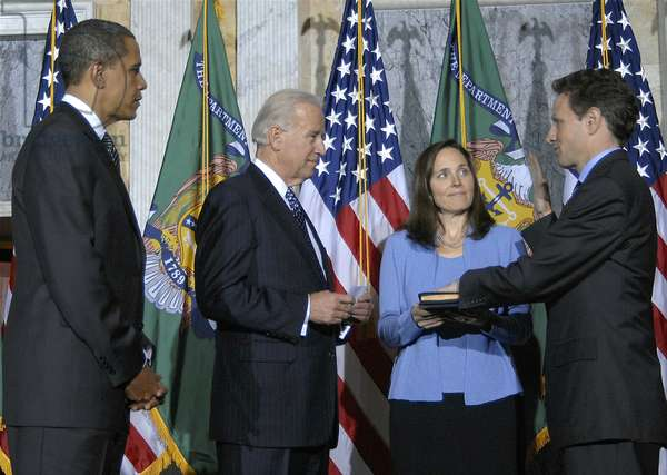 Timothy Geithner sworn-in as Secretary of the Treasury by VP Joe Biden on January 26 2009. President Obama and Carole Sonnenfeld Geithner look on. (BSWH_2011_8_111)