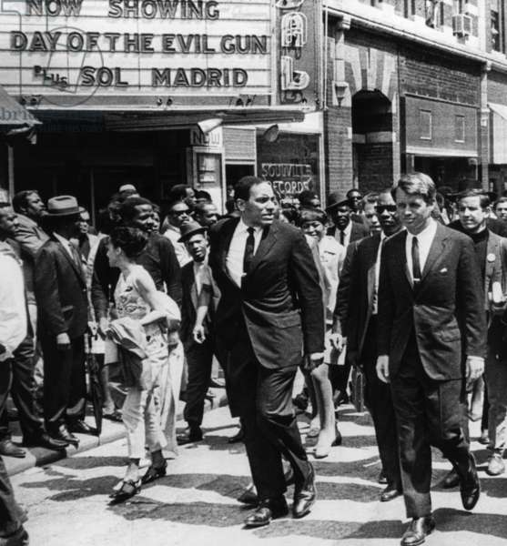 New York Senator Robert Kennedy (right), marching in the funeral procession honoring fallen civil rights leader Dr. Martin Luther King, Jr., April 9, 1968.