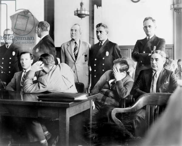 Louis Buchalter at murder trial, Louis 'Lepke' Buchalter (sitting, left), Emanuel 'Mendy' Weiss (covering face, second from left), Phillip 'Little Farvel' Cohen (covering face, second from right), and Louis Capone (right), in a Kings County Courtroom during jury selection, Brooklyn, New York, photograph by Al Aumuller, 1941