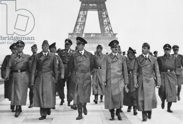 Adolf Hitler touring conquered Paris with his entourage at the Eiffel Tower. Hitler is flanked on the left by architects Hermann Giesler and Albert Speer; on the right by sculptor, Arno Breker. World War 2, June 23, 1940