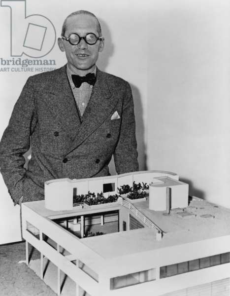 Le Corbusier (1887-1965), revolutionary French architect with a model of his ultra-modern residence, Villa Savoye. 1935