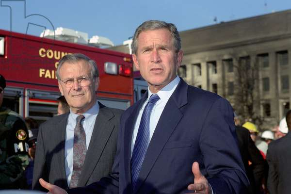 President George W. Bush and Donald H. Rumsfeld left Sec. of Defense address the media outside the Pentagon Washington DC. on Sept. 12 2001 the day following the Al-Qaeda terrorist attacks