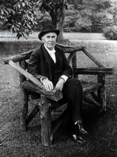 Thomas Edison sits on a bench on his Llewellyn Park, New Jersey estate, February 15, 1914.