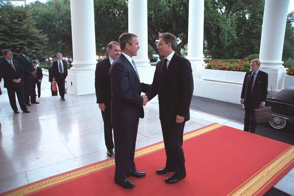 Pres. George W. Bush greets PM Tony Blair at the White House on Sept. 20, 2001. Blair would be in the audience with the First lady, during Bush 43's speech to a Joint Session of Congress that night. Operation Enduring Freedom combat in Afghanistan would start on October 7, 2001 and Britain would provide significant military support and troops