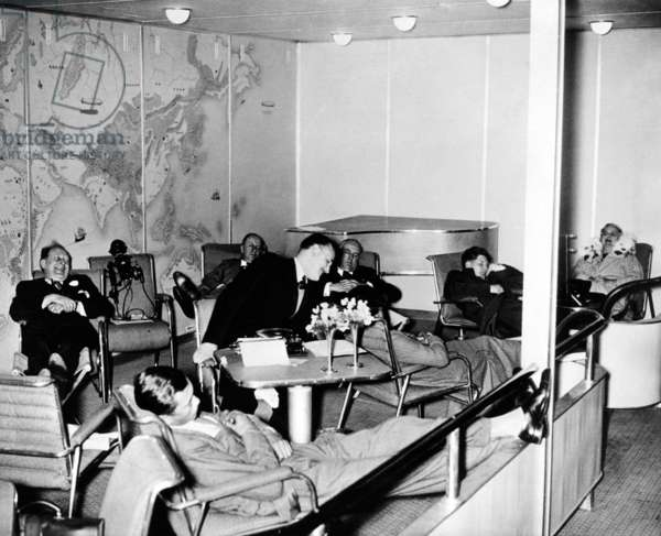 High life on the Hindenburg. Passengers aboard the Hindenburg at ease in the salon as the dirigible flew over the mid-Atlantic, en route to Lakehurst, NJ. May 10, 1936.