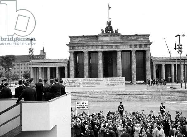 JOHN F. KENNEDY-Viewing the Berlin Wall from a platform at the Brandenburg Gate, Berlin. 6/27/63
