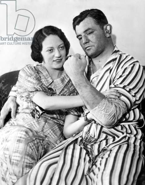 James Braddock shows off to wife May the left that confounded Max Baer and won him the Championship. Mayflower Hotel, NY, NY, June 15, 1935