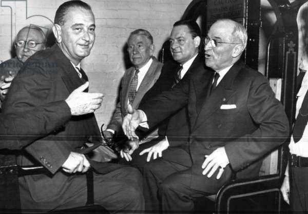 Senators Walter George, Lyndon B. Johnson, Alben Barkley, Thomas Hennings and former President Harry Truman ride the Senate Subway from the Senate Office Building to a luncheon honoring Truman. April 18, 1955.