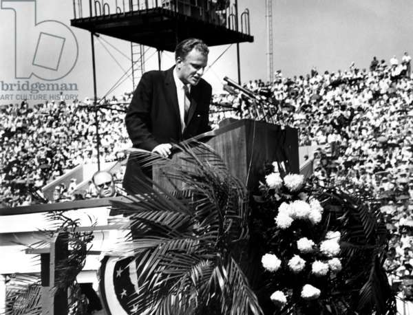 Evangelist, Billy Graham preaching to a crowd at the Chicago Crusade Revival.June 17, 1962. Chicago, Illinois.