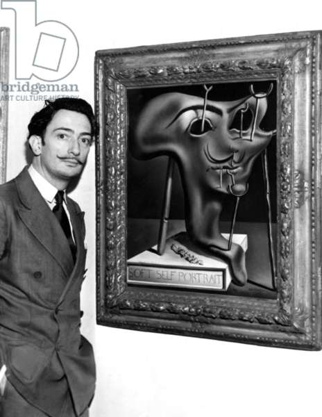 Salvador Dali, showing off his piece entitled 'Soft Self Portrait' at the Julien Levy Gallery in New York, c. 1941