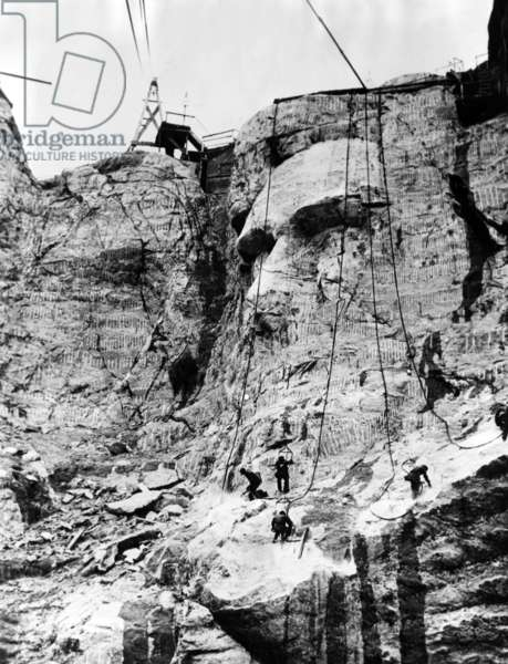 MOUNT RUSHMORE, workers resume work on Abraham Lincoln's chin after breaking for winter, South Dakota, Black Hills, May, 5, 1937