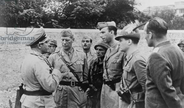 'Italians of the traitorous Badoglio system being interrogated by German officers in Rome'. So reads the German caption of this photo. After the Sept. 8, 1943 overthrow of Mussolini and the Italian switch to the Allies side in World War 2, Germans disarmed Italian soldiers. 'Badoglio' refers to the new Italian Prime Minister, Grazzano Badoglio. World War 2