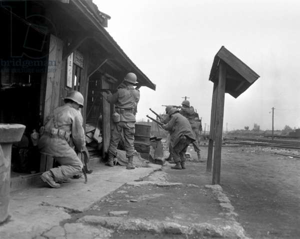 Soldiers of the 1st Cavalry Division fighting in a train yard in Pyongyang, Korea. They entered the North Korean city on Oct. 19 and secured it by Oct. 22, 1950. Korean War, 1950-53