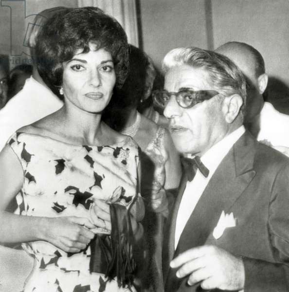 ARISTOTLE ONASSIS, with opera star MARIA CALLAS, out at Monte Carlo's International Sporting Club, following a charity ball given by Prince Rainier & Princess Grace, c. August 1960