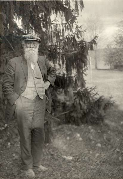 John Burroughs (1837-1921) author and naturalist, standing outside his home in upstate New York in 1914