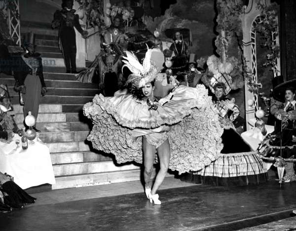Josephine Baker performs at the Folies Bergeres theater in Paris, 1949