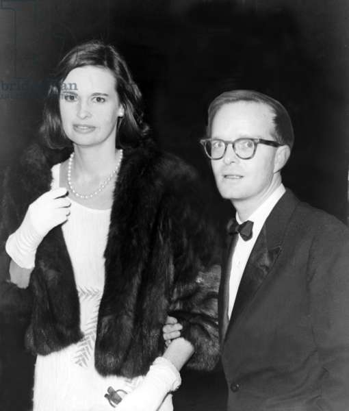 Truman Capote (1924-1984), southern American writer with socialite Gloria Vanderbilt in 1965