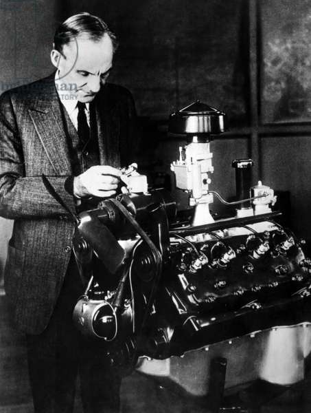 Henry Ford inspecting his new 'V-8' motor. c. 1932