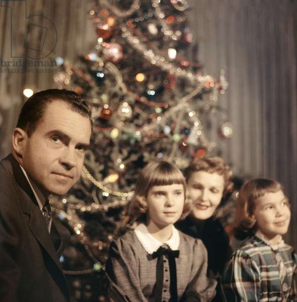 Richard Nixon at Christmas with his daughter Tricia, wife Pat and daughter Julie, c.1950s, photo by Robert Phillips / Courtesy Everett Collection