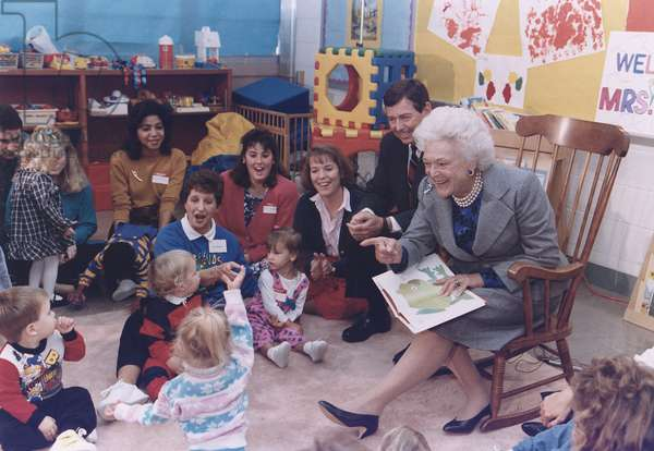 First Lady Barbara Bush and Missouri Governor John Ashcroft attend a 'Parents as Teachers' gathering at a public school in Florissant Missouri where she read BROWN BEAR BROWN BEAR to the children. 1991