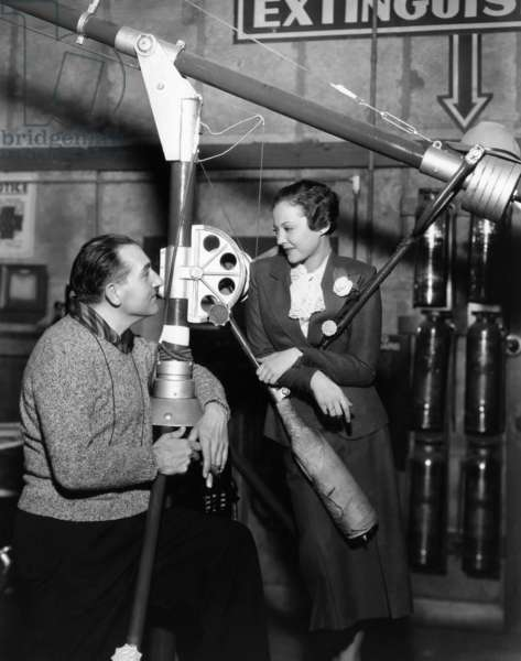 THE FURY, director Fritz Lang, directing Sylvia Sidney, on set, 1936