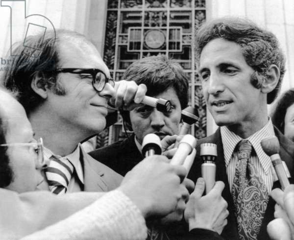 The Pentagon Papers. Foreground from left: Co-defendants Anthony Russo and Daniel Ellsberg talk to reporters at the Los Angeles Federal Building after the judge stopped proceedings when additional wiretaps by the government were revealed. The judge ordered the government to find all records on electronic surveillance of Ellsberg immediately. May 10, 1973