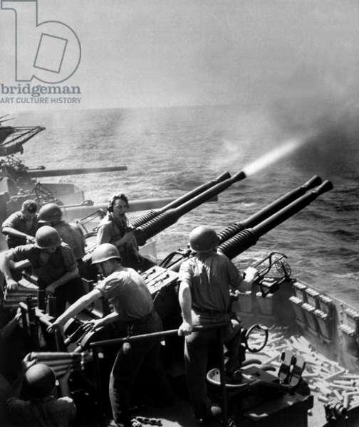 USS Hornet's 40mm guns firing as the carrier's planes were raiding Tokyo, Feb. 16, 1945. World War 2, Pacific Ocean