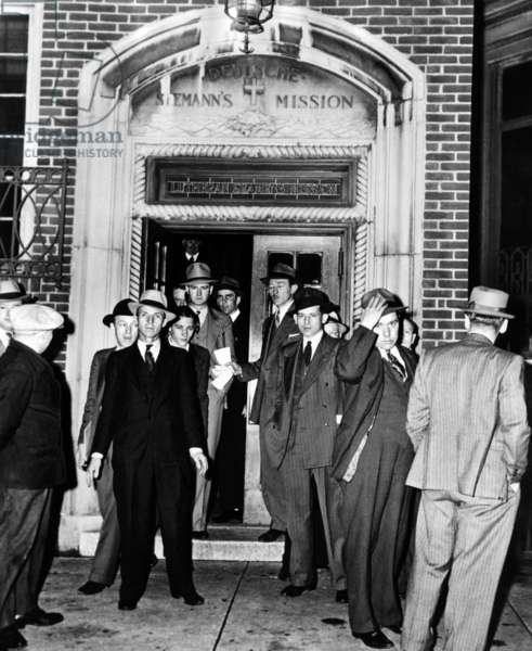 German aliens leaving the Deutsche Seaman Mission on Hudson Street for Ellis island in the custody of U.S. Immigration Service agents. They were unable to work for their employers after war broke out in Europe. May 7, 1941