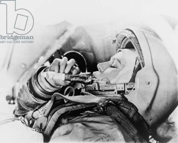 Valentina Vladimirovna (b.1937) Russian cosmonaut and the first woman in space eating from a food tube during training