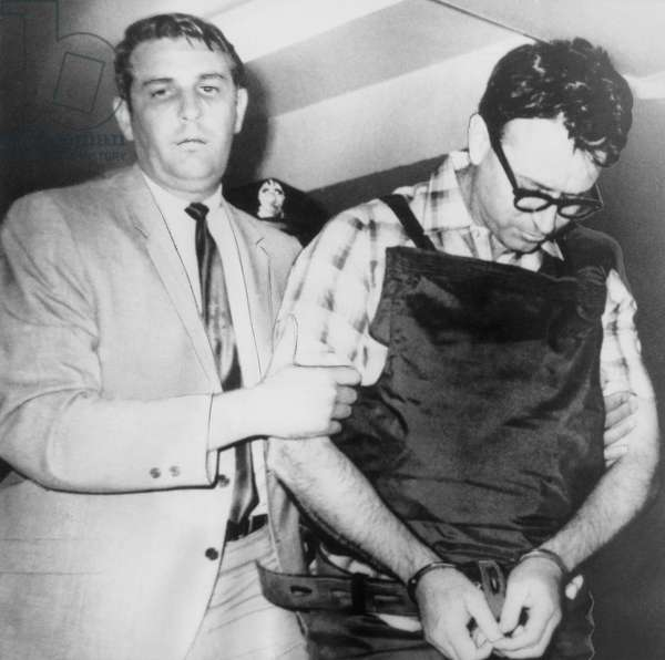 James Earl Ray, assassin of Dr. Martin Luther King Jr. being taken to his cell by Sheriff William Morris, upon his arrival in Memphis Tennessee, July 19, 1968