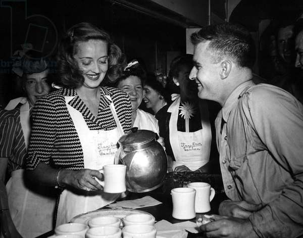 Bette Davis doing her part at the Stage Door Canteen during World War II