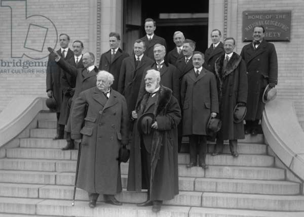 Famous inventor, Alexander Graham Bell, on the steps of the National Geographic Society to celebrate the anniversary of the Bell Telephone, 1916. Bell in in front right, next to Theodore Vail. Directly behind Bell is Thomas A. Watson