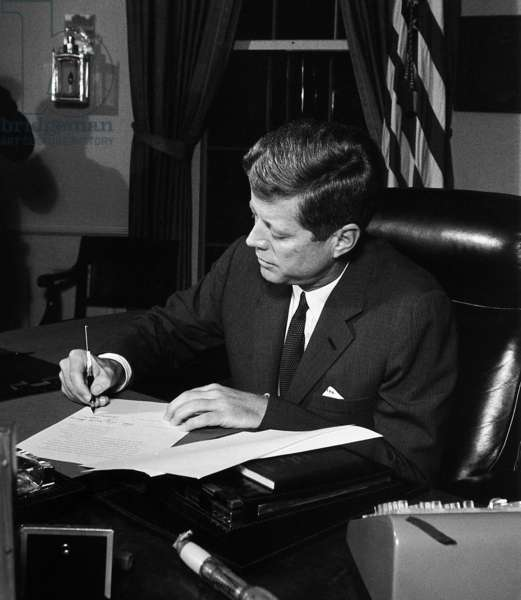 President Kennedy signing Cuba Quarantine Proclamation. The US Navy blockade would prevent the delivery of additional Soviet missiles to the Communist island nation. Oct. 23, 1962