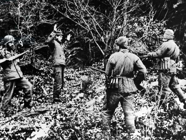 Two UN soldiers (probably U.S.) captured by North Korean soldiers. Probably in South Korea, c. July-Oct. 1950. Prisoners taken by North Koreans in the first six months of the war faced harsh, and often fatal, treatment from Koreans captors. Korean War, 1950-53