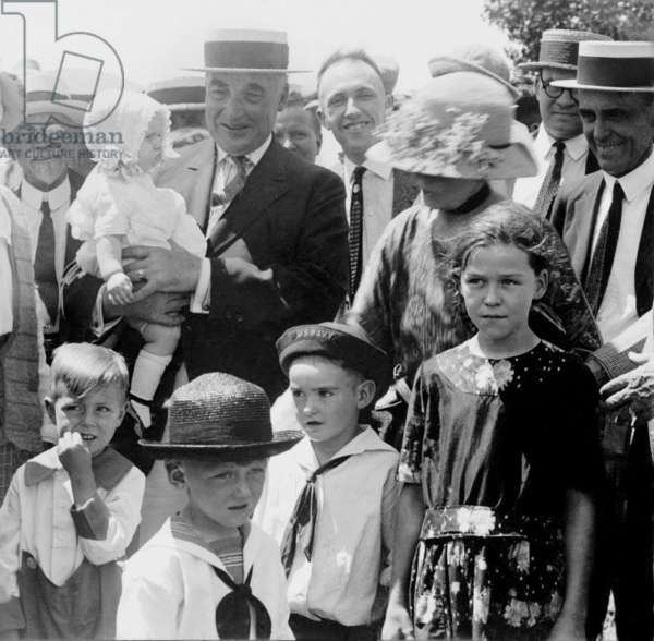 Warren G. Harding (1865-1923), holds the baby and talks to the farmers, Hutchinson, Kansas during his 1923 Western tour