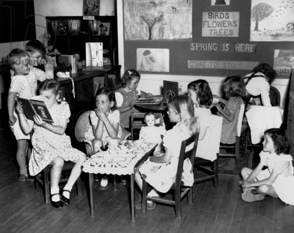 Young children at the Pine Valley School, Oak Ridge, Tennessee. Some are reading, other are playing 'tea party'. April 20, 1945. Photo by Ed Westcott