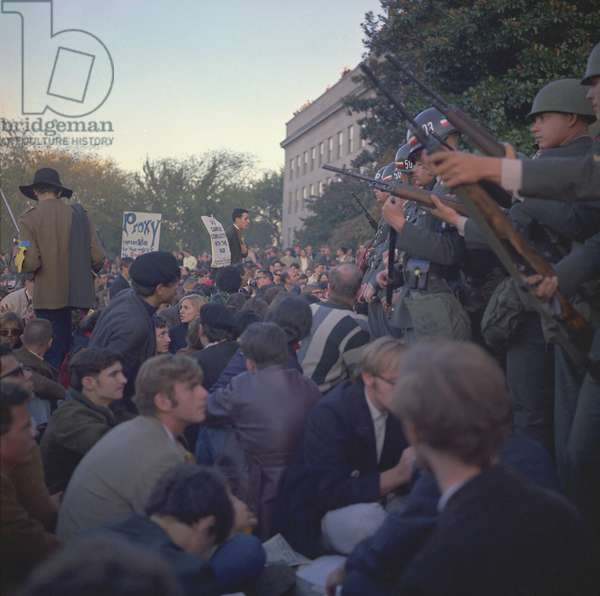 March on the Pentagon. Military police keep back protesters at the Mall Entrance to the Pentagon. 100,000 protesters participated in the Washington D.C. demonstration which besieged the Pentagon from October 21 until the early hours of October 23, 1967