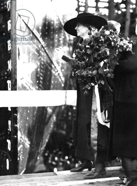 Helen Keller, the blind and deaf writer, christens a ship during World War I. The United States Emergency Fleet ship was the twelfth boat launched by the Los Angeles Shipbuilding & Dry Dock Company. c. 1918