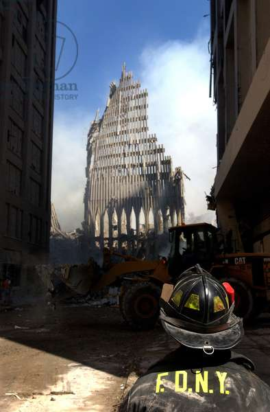 A New York City firefighter stands before a still standing section of the World Trade Center after the Sept. 11th terrorist attacks. Sept. 13 2001,