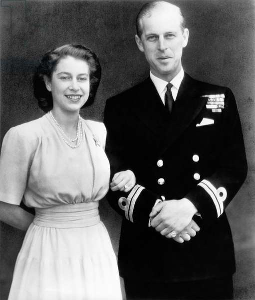 British Royalty. Future Queen of England Princess Elizabeth and Lieutenant Philip Mountbatten (future Duke of Edinburgh Prince Philip), offical engagement photo, 1947