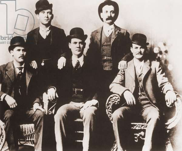 Butch Cassidy's Wild Bunch gang of train robbers in portrait taken in Fort Worth, Texas in 1901. Left to right, seated: Harry A. Longabaugh, alias the Sundance Kid, Ben Kilpatrick, alias the Tall Texan, Robert Leroy Parker, alias Butch Cassidy. Standing- Will Carver, alias News Carver and Harvey Logan, alias Kid Curry. Paul Neuman and Robert Redford starred in the 1967 film, BUTCH CASSIDY AND THE SUNDANCE KID