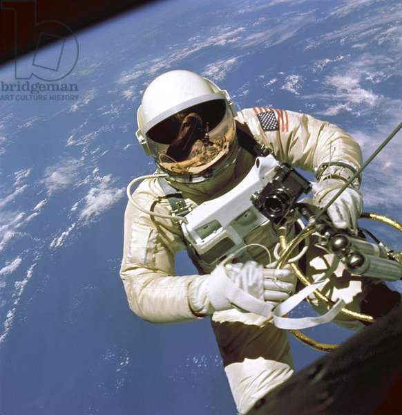 Astronaut Edward White floats in space. The Gemini 4 pilot was attached to the spacecraft by a 25-ft. umbilical line that provided oxygen. June 3, 1965
