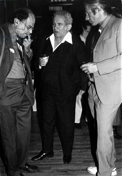 Allen Ginsberg, Norman Mailer, and Peter Orlovsky at a party, 1978